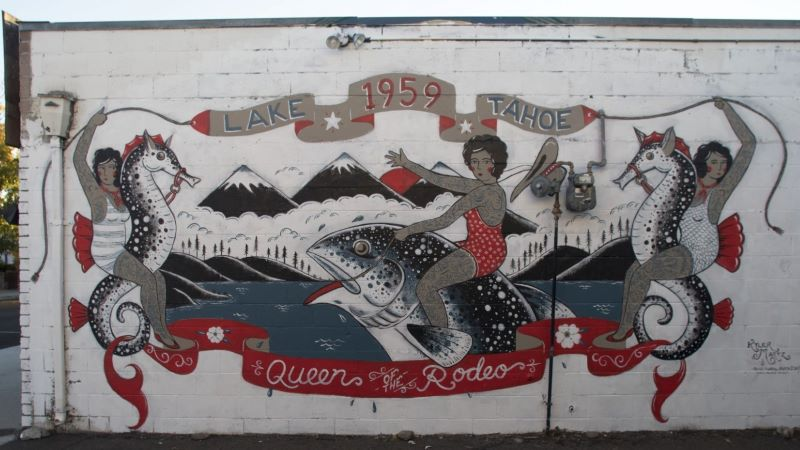 Street art with tattooed women in bathing suits riding seahorses and a fish with banners that say Lake Tahoe 1959 Queen of the Rodeo