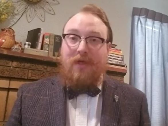 W. M. Keck Earth Science and Mineral Engineering Museum curator Garrett Barmore wearing a bow tie